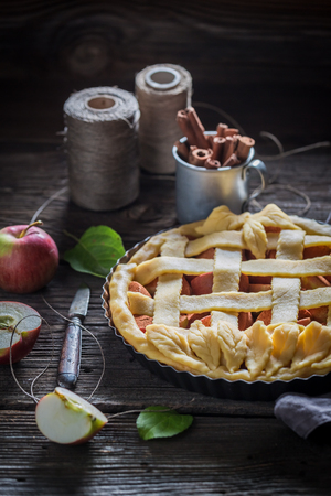 Homemade tart with apples with cinnamon and fresh fruits