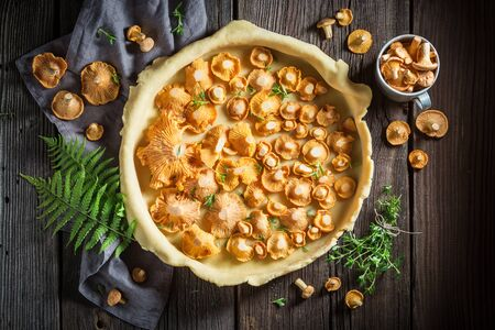 Homemade and rustic pie made of wild mushrooms and herbs