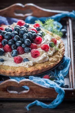 Sweet pie with fresh blueberries and raspberries Stock Photo