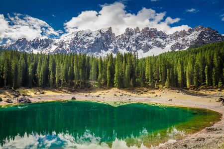 Stunning green mountain Carezza lake in Dolomites, Italy, Europe Stock Photo