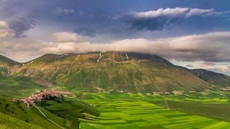 Sunset in the mountains over Castelluccio, Italy Reklamní fotografie