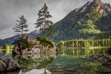 Foggy sunrise at Hintersee lake in Alps in summer