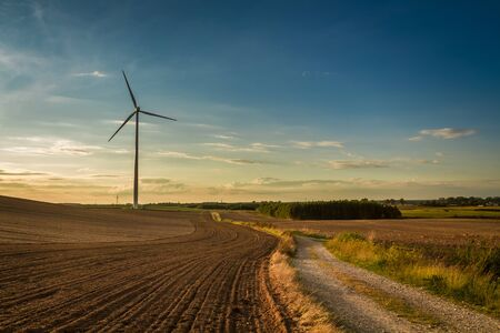 Beautiful sunset at countryside with wind turbine