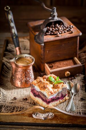 Fresh cherry pie with pot boiled coffee