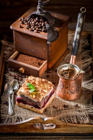Tasty cherry pie with coffe grinder and grains