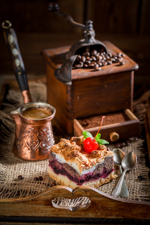 Sweet cherry pie with pot boiled coffee Stock Photo