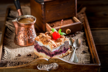 Fresh cherry pie with coffe grinder and grains