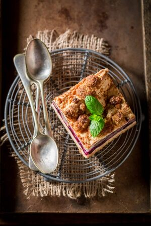 Sweet cherry pie with coffe grinder and grains