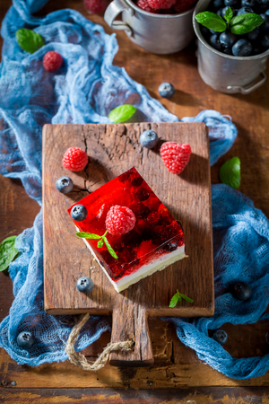 Delicious cake with jelly and berry fruits