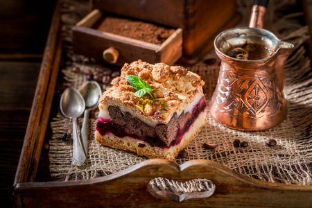 Delicious cherry pie with coffe grinder and grains Stock Photo