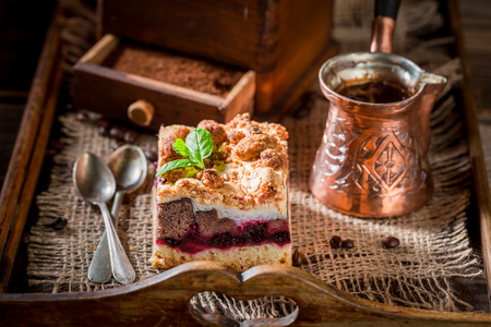 Rustic cherry pie with coffe grinder and grains Stock Photo