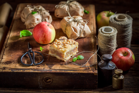 Sweet take away apple pie with crumble and icing Stock Photo
