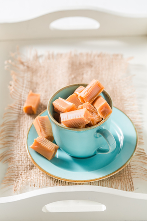 Homemade toffee cake with fudge bars on blue porcelain Stock Photo