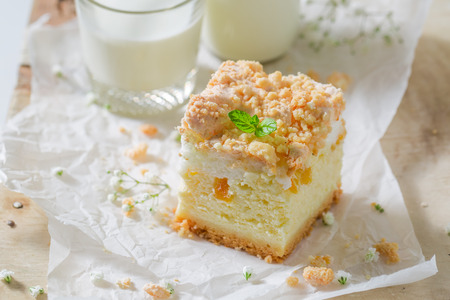 Tasty cheesecake with fresh peach and crumble