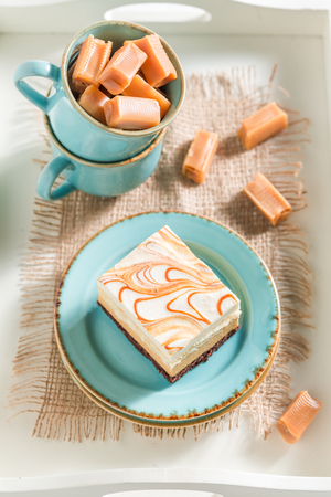 Homemade toffee cake on blue porcelain with fudge bars Stock Photo