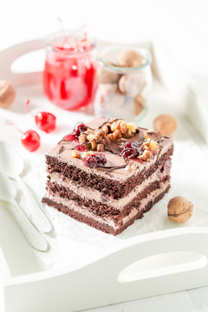 Fresh chocolate cake with cherry and nuts