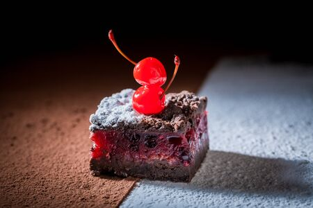 Delicious chocolate cake with crumble and cherry Stock Photo