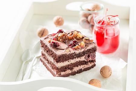 Yummy chocolate cake with walnuts and cherry Stock Photo