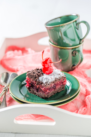Sweet chocolate cake with cherry and crumble Stock Photo