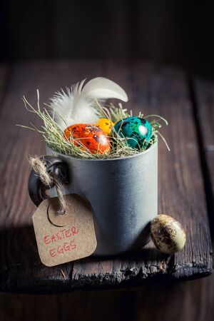 Farm eggs for Easter in small metal mug