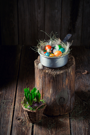 Colorful eggs for Easter in the rustic cottage Stock Photo