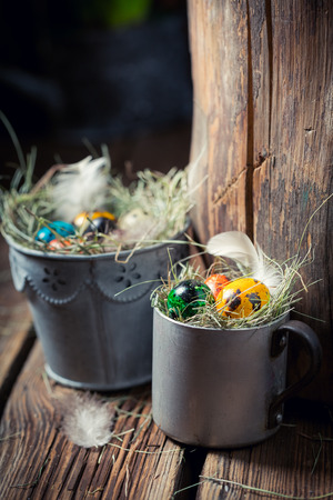 Closeup of farm Easter eggs in wooden small henhouse