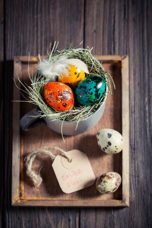 Farm eggs for Easter in the rustic mug Stock Photo
