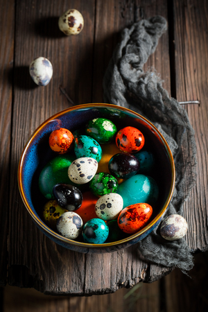 Quail and hen Easter eggs on wooden table Stock Photo