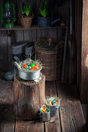 Farm Easter eggs in the wooden cottage Stock Photo