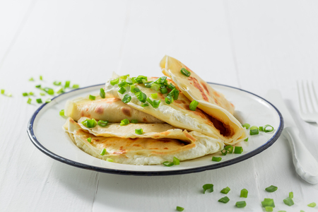 Closeup of pancakes with cottage cheese and chive 版權商用圖片