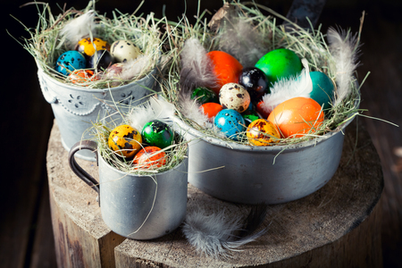 Closeup of eggs for Easter in nest and old mug