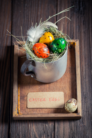 Various eggs for Easter in the rustic mug