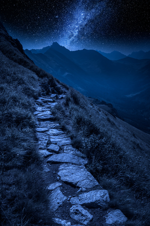 Mountains trail in Tatras at night with stars, Poland