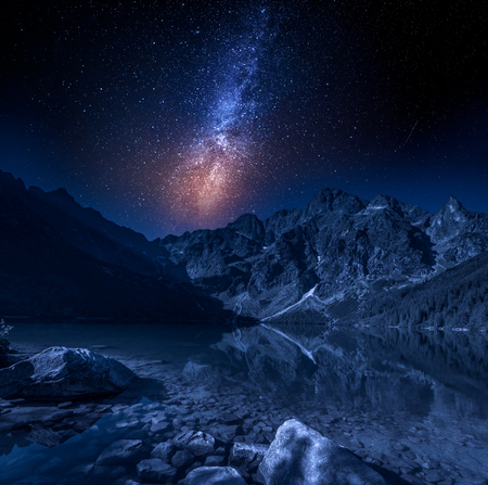 Milky way at the mountains lake at night, Poland, Europe Standard-Bild