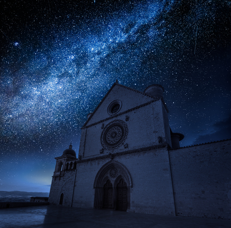 Wonderful basilica in Assisi at night with stars, Umbria, Italy