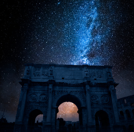 Famous Triumphal arch in Rome at night with stars, Italy