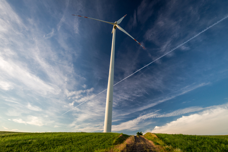 Wind turbines on green field as alternative energy  Banco de Imagens