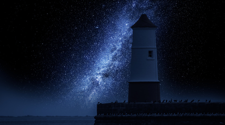 Milky way and lantern in enter to the sea