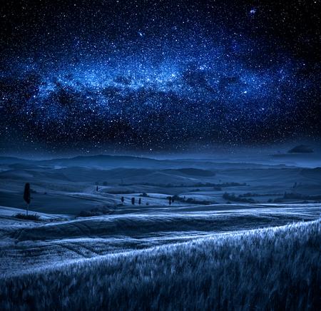 Field in Tuscany at night with milky way, Tuscany, Italy
