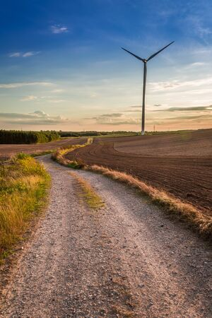 Wonderful sunset at countryside with wind turbine, Europe