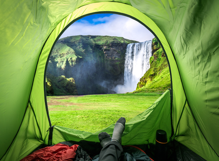 View from tent and Skogafoss waterfall in summer, Iceland  Reklamní fotografie