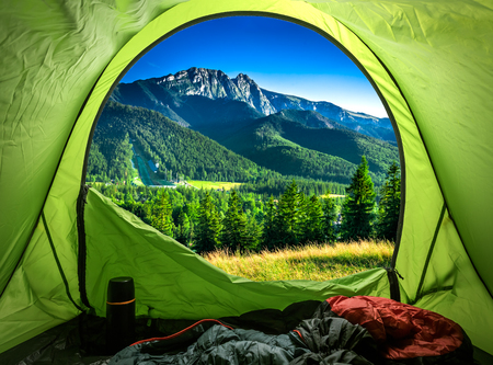 View from tent to sunset in mountains in summer, Poland  Banque d'images