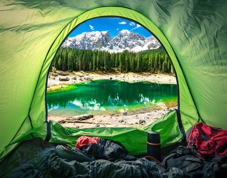 View from tent in mountain Carezza lake, Alps, Italy, Europe Stok Fotoğraf
