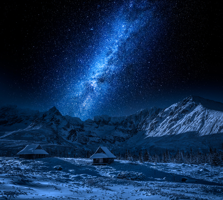 Small hut in mountain at night and milky way