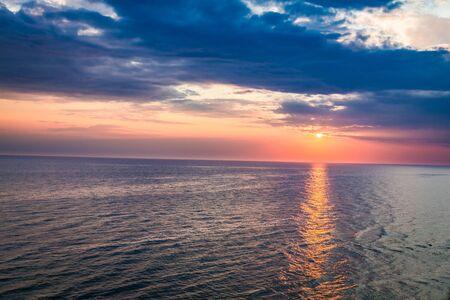 Beautiful dusk over calm ocean with sun beam, Europe