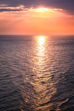 Wonderful dusk over calm ocean in summer, Europe