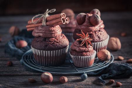 Sweet cupcake made of brown cream, nuts and chocolate