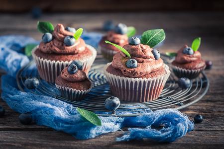 Homemade muffin with fresh chocolate, blueberries and cream