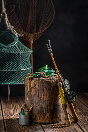 Retro angler equipment with fishing rod and lures