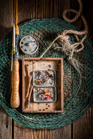 Vintage fishing tackle with fishing flies and rods
